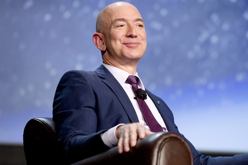 Jeff Bezos, chief executive officer of Amazon.com Inc. and founder of Blue Origin LLC, smiles during the 32nd Space Symposium in Colorado Springs, Colorado, U.S., on Tuesday, April 12, 2016. Commercial space exploration can advance at the fast pace of Internet commerce only if the cost is reduced through advances in reusable rockets, Bezos said. Photographer: Matthew Staver/Bloomberg *** Local Caption *** Jeff Bezos